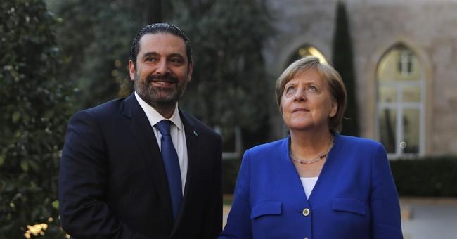 Merkel pledges $100 million loan for troubled Jordan