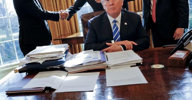 Trump bends, but doesn't break, ways of Washington in year 1