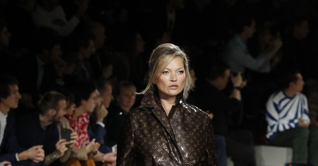 Stars turn out for swansong of Louis Vuitton designer