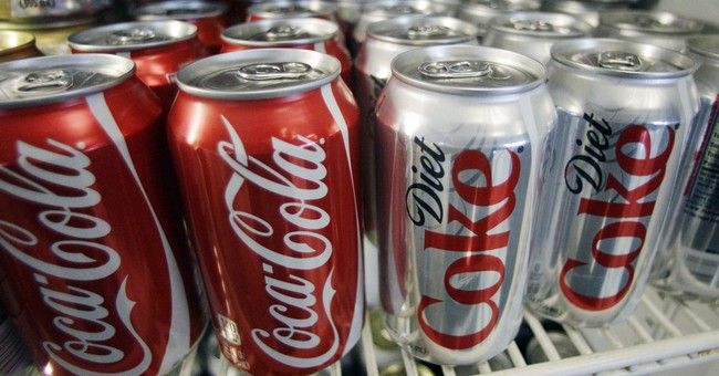 """Seeing global """"packaging problem"""" Coke vows to cut waste"""