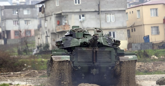 Turkey faces balancing act amid border offensive in Syria