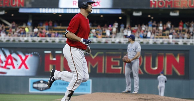 Mauer homers, drives in four as Twins outlast Rays 11-8