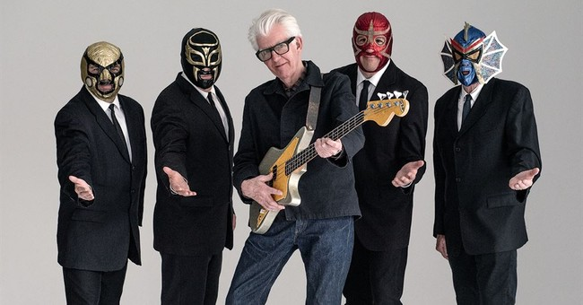 Nick Lowe rediscovers roots with Los Straitjackets