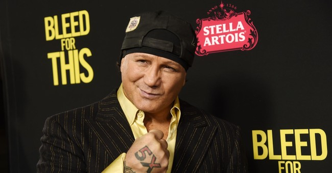 The Latest: Arrest warrant issued for ex-boxer Vinny Paz