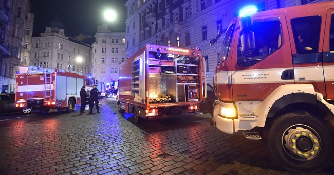 Prague hotel fire kills 2, dozens injured