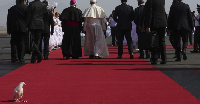 The Latest: Pope decries killings of women, other violence