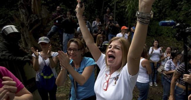 Opposition: Venezuelan officials bury 2 killed in clash