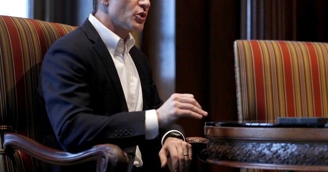 Embattled Missouri governor proposes more cuts to colleges