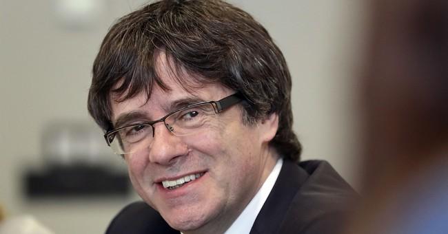 Spain drops intl arrest warrants for Puigdemont