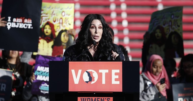 The Latest: Cher tells marchers to use their voice and vote
