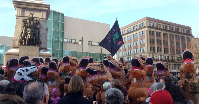 Dozens dressed as Tyrannosaurus rex descend on public square