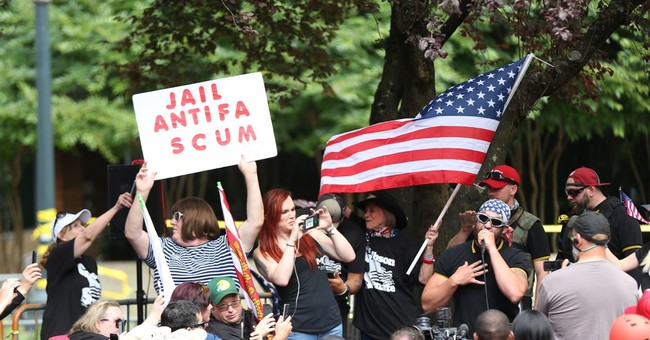 Right-wing and anti-fascist demonstrators square-off in Portland