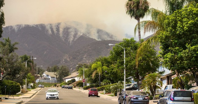 Man charged in California wildfire refuses to go to court
