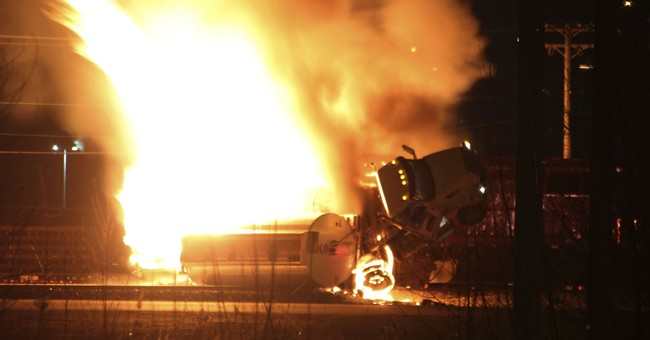 Fire doused after tanker truck, rail car collide in Canada