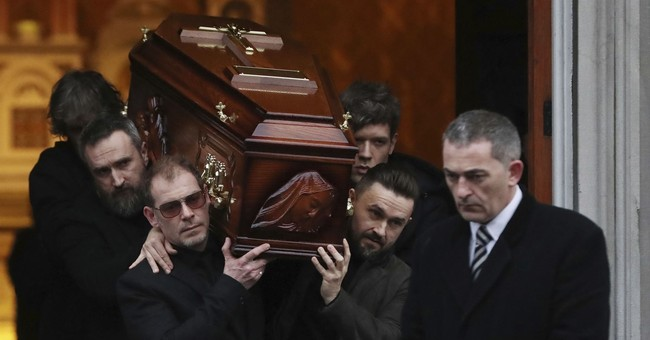 Bandmates, family attend funeral of Cranberries singer