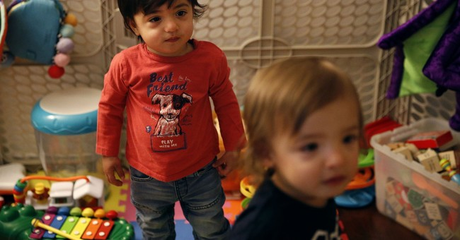 Gay couple sues US for denying citizenship to 1 twin son