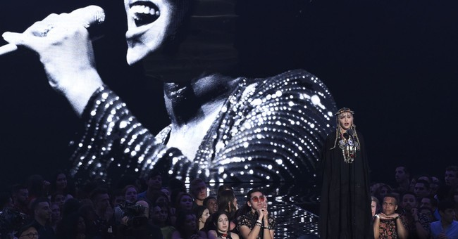 Madonna defends 'self-indulgent' tribute to Aretha Franklin