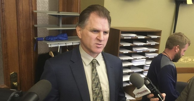 Wisconsin elections panel retains embattled administrator