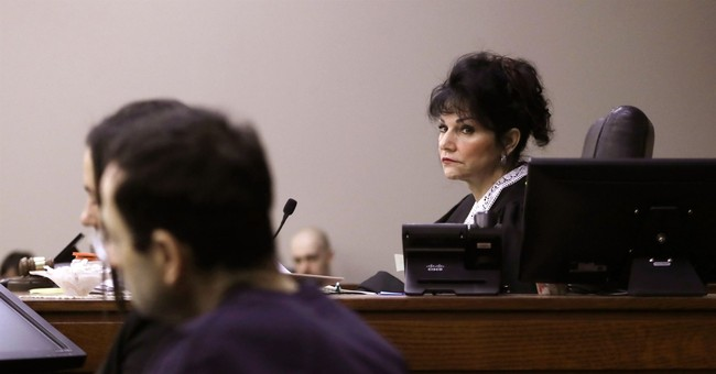 Doctor's letter elicits groans, gasps in packed courtroom