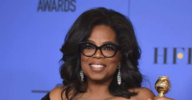 Oprah visits Alabama grave of woman honored in Globes speech