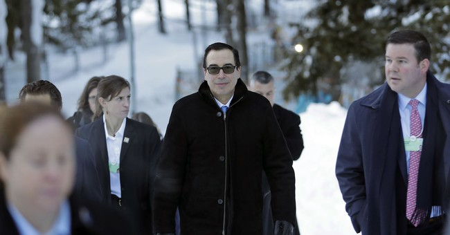 Trump heads to Swiss forum to push economic policies