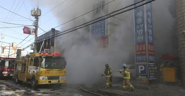 The Latest: Pope sends condolences on hospital fire