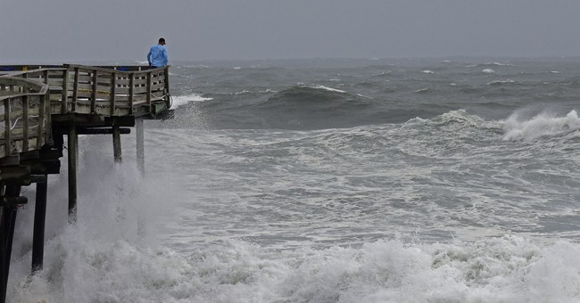 The Latest: Forecast: Florence threat continues overnight