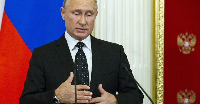 Putin absolves Israel, sees downing of Russian plane off Syria as accident