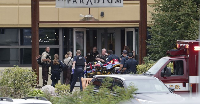 Man opens fire at his Wisconsin office, 3 seriously hurt