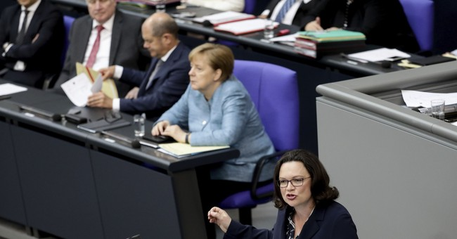 Angela Merkel tries to defuse coalition crisis