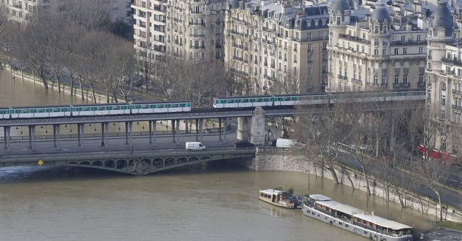 Rain-swollen Seine burst its banks, engulfs quays