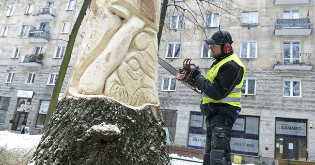 Doomed trees reborn as art in Warsaw's Fairytale Square