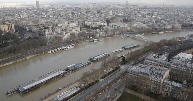 Rain-swollen Seine burst its banks, engulfs quays