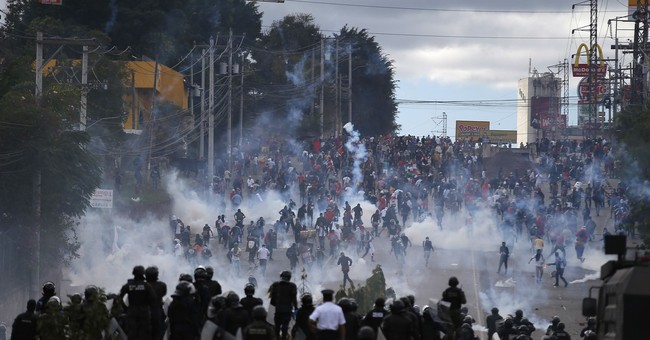 Honduran president starts new term as fiery protests erupt