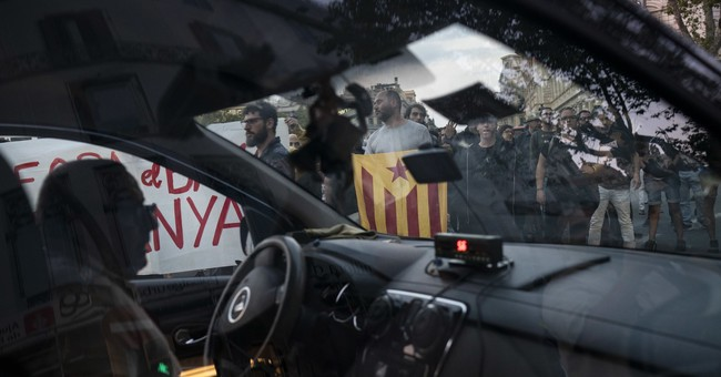 The Latest: Catalan students march in favor of independence