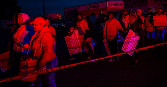The Latest: US House candidate arrested in wage protest