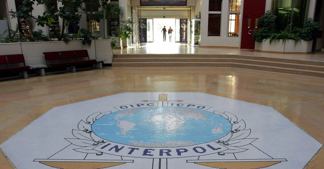 China says Interpol chief being probed on suspicion of violating the law