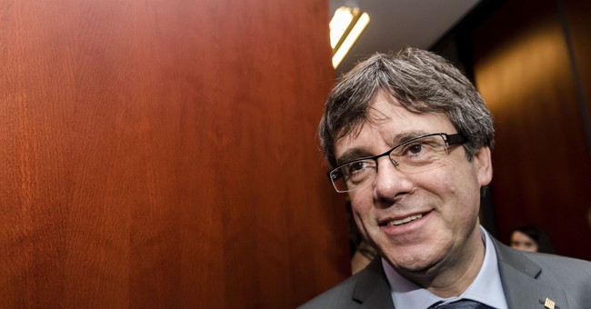 Fugitive Catalan chief seeks parliament protection for vote