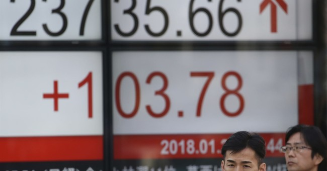 Asian shares mixed as benchmarks fall back after upbeat open