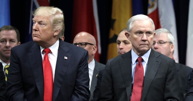 Sessions soldiers on as AG despite Trump criticism