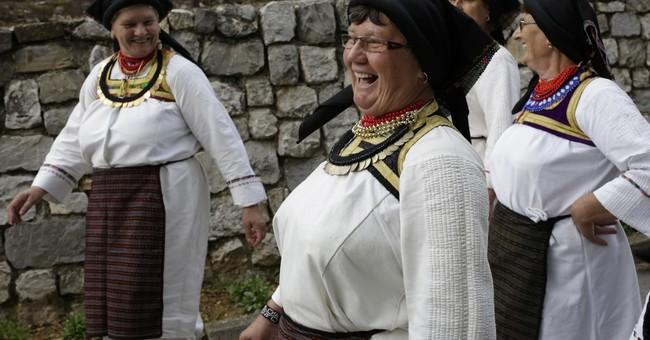 Bosnia village women don folk dresses on election day
