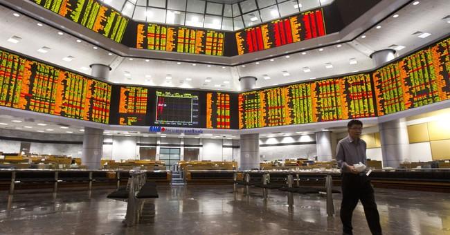 World stocks slide after IMF trims economic outlook