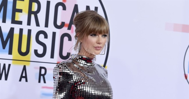 The Latest: Swift wins at AMAs, encourages fans to vote