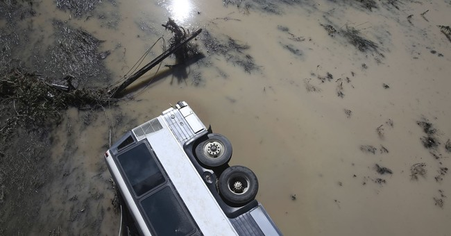Search for 4 people missing in Texas flooding ends for day