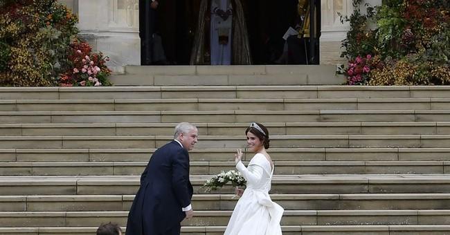 The Latest: British designers made Eugenie's wedding dress