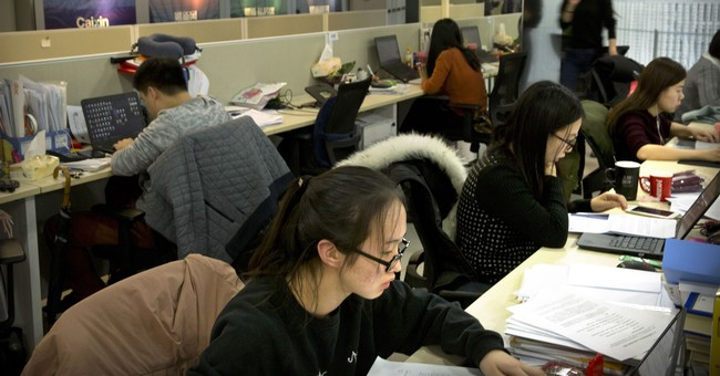 AP Interview: Chinese editor Hu Shuli steps aside, not down