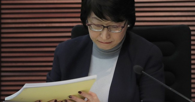 Hong Kong's new justice chief dogged by property scandal
