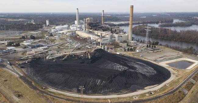 Facing new scrutiny, powerful utility turns to old friends
