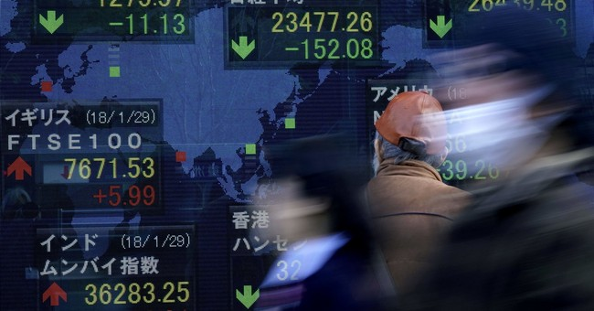 Asian shares lower, tracking modest pullback on Wall Street