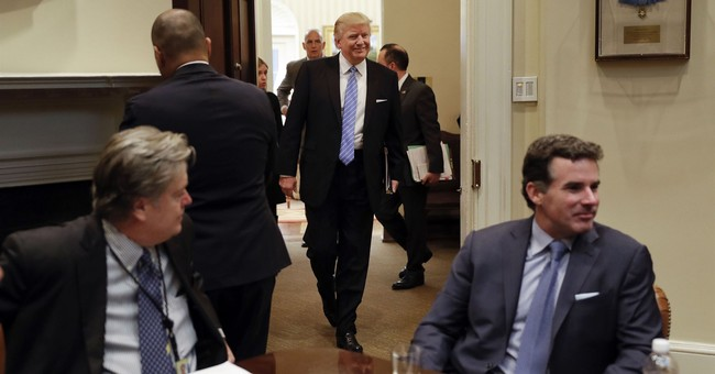 The Latest: Trump lawyer threatens Bannon with legal action